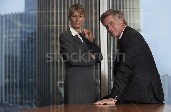 Gens d'affaires supérieurs homme d'affaires femme boardroom souriant Photo stock © gemphoto