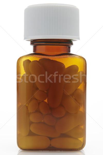 Vue pilules bouteille blanche médicaments Photo stock © gemphoto