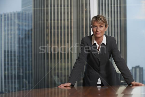 Femme d'affaires président boardroom regarder caméra Photo stock © gemphoto