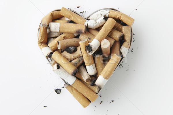 Cigarette métal coeur cendrier santé Photo stock © gemphoto