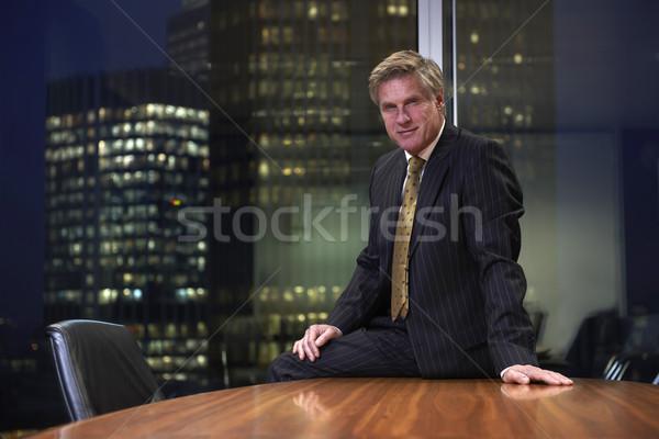 Iş adamı oturma tablo Boardroom bakıyor kamera Stok fotoğraf © gemphoto