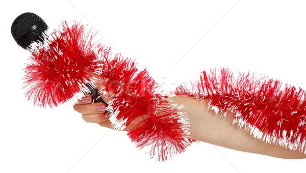 Vrouwelijke hand Rood guirlande microfoon Stockfoto © GeniusKp