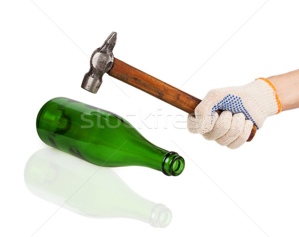 Working hand in glove holding a hammer over a green bottle Stock photo © GeniusKp