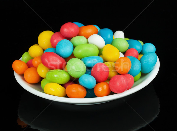 colored candies in white saucer Stock photo © GeniusKp
