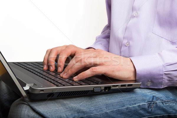 Businessman hands on laptop keyboard typing closeup Stock photo © GeniusKp