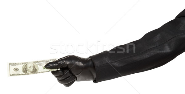 Thief in black suit holding dollars Stock photo © GeniusKp