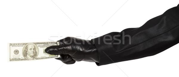 Hand zwarte handschoen geld geïsoleerd Stockfoto © GeniusKp