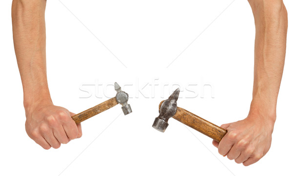 Two old hammers in hands Stock photo © GeniusKp