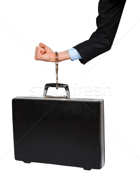 Hand in black suit with handcuffs chained to the black case Stock photo © GeniusKp