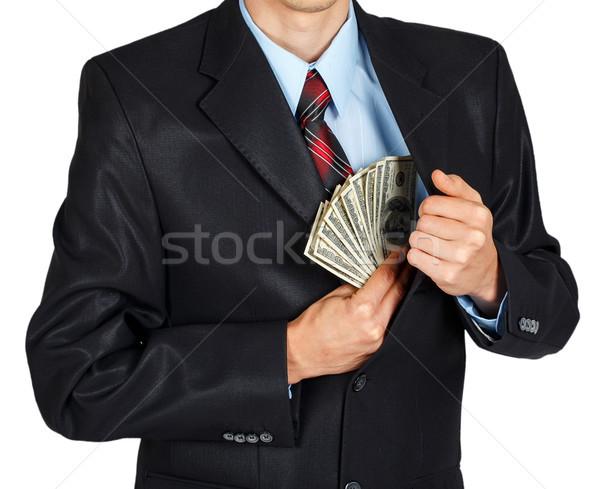 Man pulls money out of his jacket Stock photo © GeniusKp