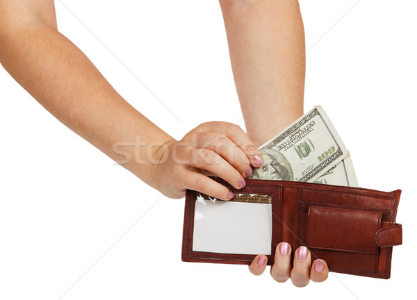 Female hands take out a hundred dollar bill from his wallet Stock photo © GeniusKp