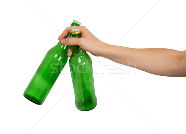 Two empty bottles of beer in a female hand Stock photo © GeniusKp