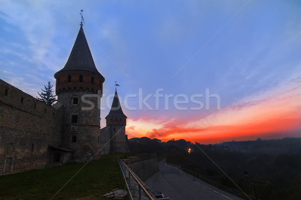 Sunset over the tower of medieval half-ruined castle Stock photo © GeniusKp