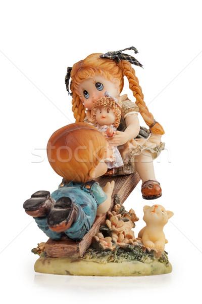 Estatueta menina menino balançar isolado branco Foto stock © GeniusKp