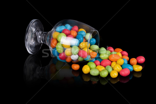 colorful candy in inverted glass Stock photo © GeniusKp