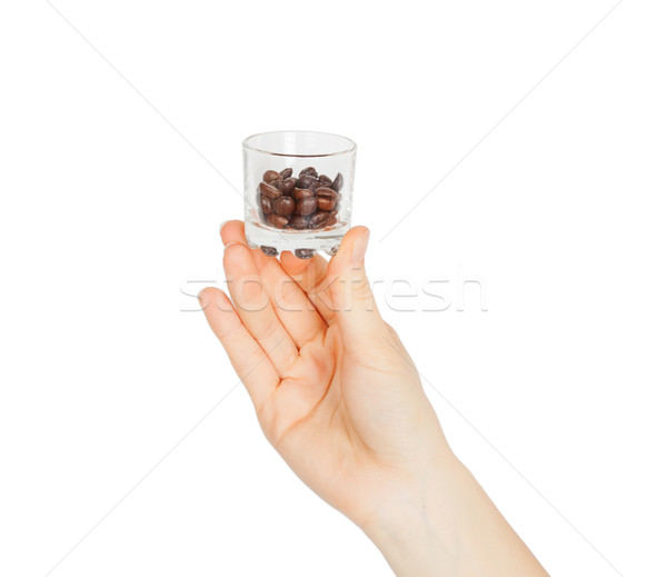 female hand holding a glass with coffee beans Stock photo © GeniusKp