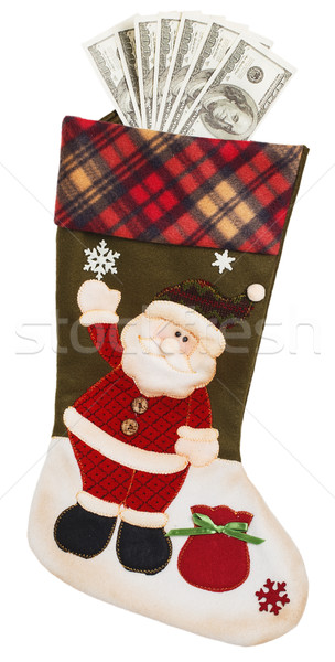 Dollars in green and white stocking with Santa Claus Stock photo © GeniusKp