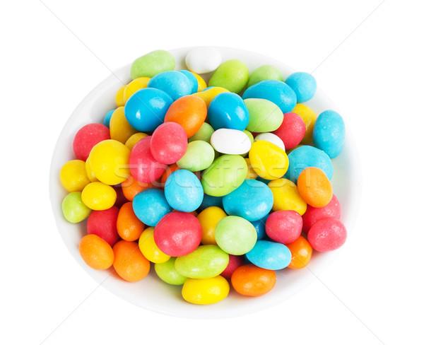 Színes cukorkák fehér csészealj izolált buli Stock fotó © GeniusKp