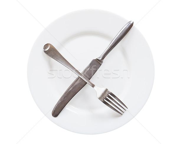 Boş beyaz plaka bıçak çatal yalıtılmış Stok fotoğraf © GeniusKp