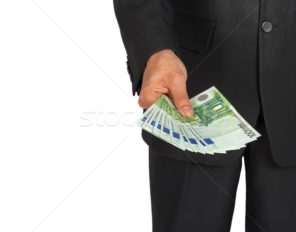 Man in a suit holds out a number of euro banknotes Stock photo © GeniusKp