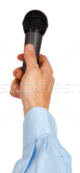 Hand Blauw shirt microfoon geïsoleerd Stockfoto © GeniusKp