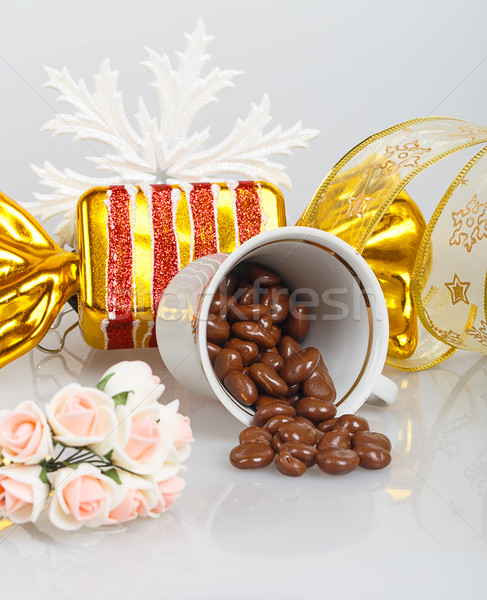 Chocolate dragees in an inverted cup with decoration Stock photo © GeniusKp