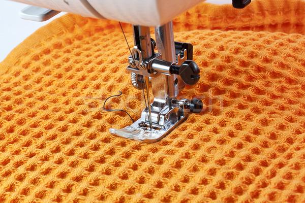 Máquina de costura trabalhando laranja pano negócio textura Foto stock © GeniusKp