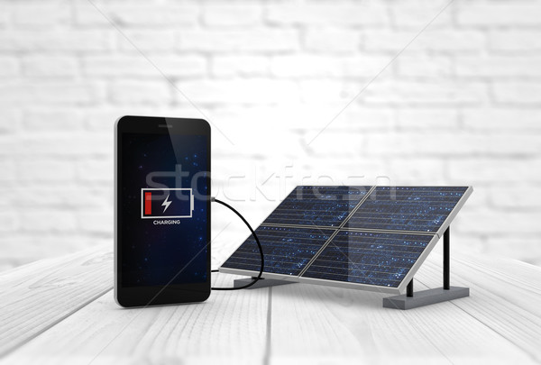 phone charging solar pannel Stock photo © georgejmclittle