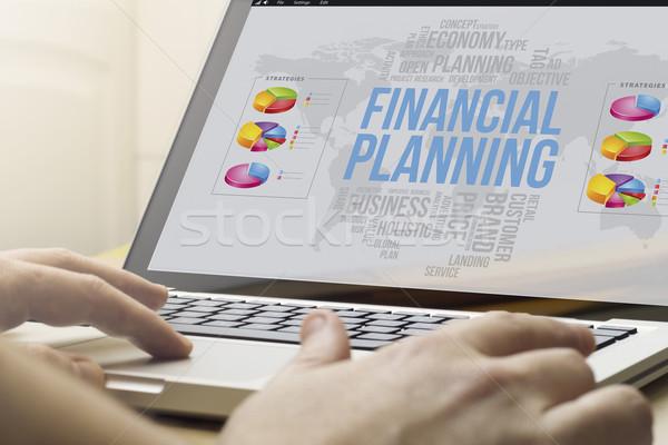 Otthon számítástechnika pénzügyi tervezés gazdaság piac férfi Stock fotó © georgejmclittle