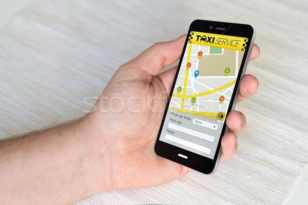 Smartphone taxi toepassing scherm hand Stockfoto © georgejmclittle