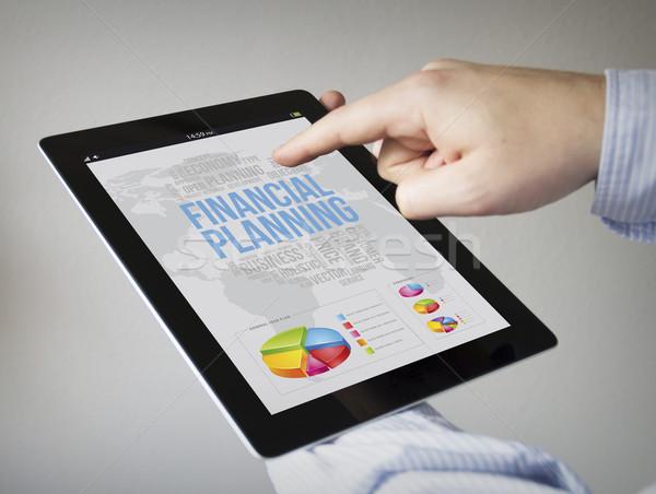 Planification financière comprimé nouvelle plan mains Photo stock © georgejmclittle
