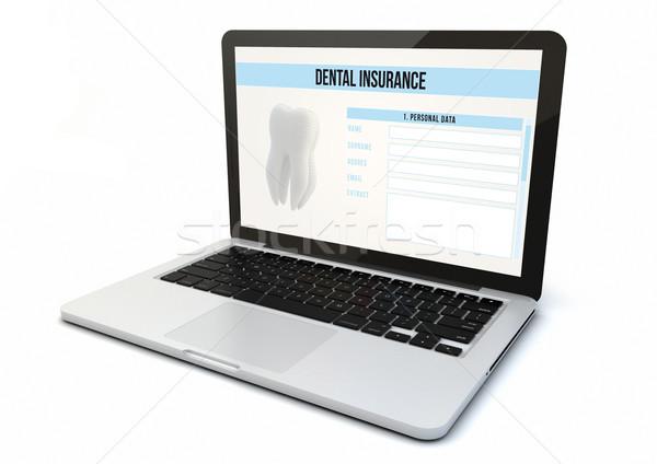 laptop dental insurance Stock photo © georgejmclittle