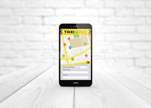такси приложение деревянный стол современных бизнеса Сток-фото © georgejmclittle