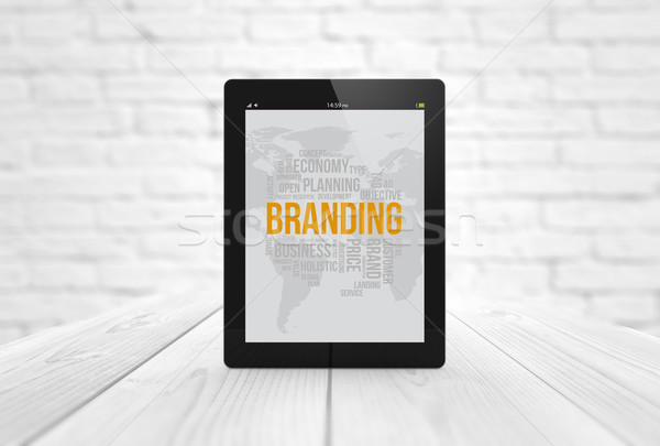 branding tablet on wooden table Stock photo © georgejmclittle