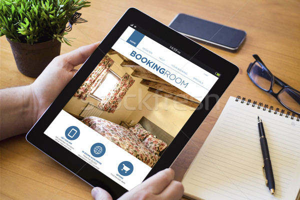 booking tablet on wooden workspace Stock photo © georgejmclittle