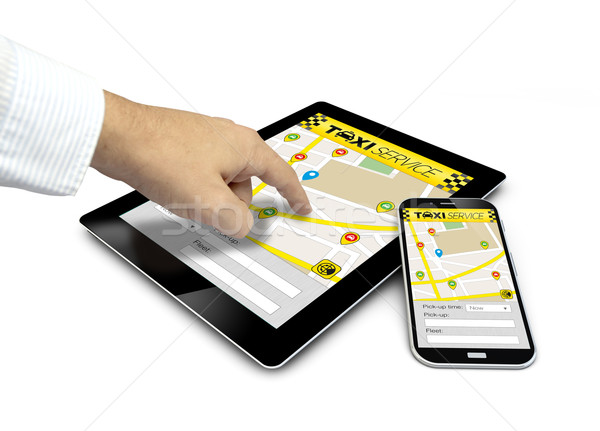 group of touchscreen devices with taxi app and a finger touching Stock photo © georgejmclittle