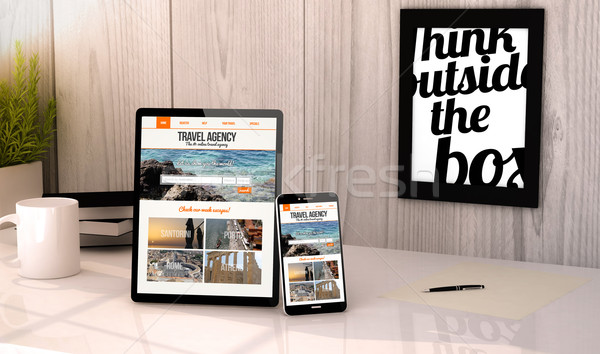 desktop tablet and phone travel agency website on screen Stock photo © georgejmclittle