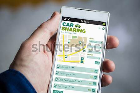 Hipster smartphone with car sharing app on the screen Stock photo © georgejmclittle