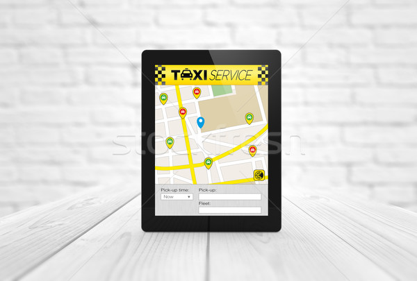 Taxi app tablet houten tafel business geven Stockfoto © georgejmclittle