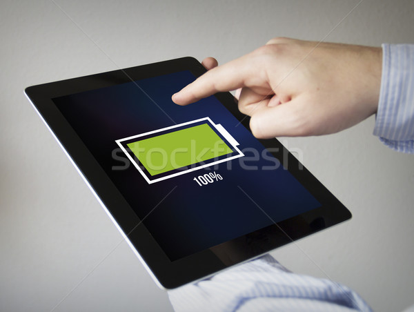 full battery on a tablet Stock photo © georgejmclittle