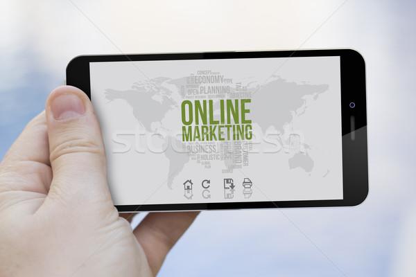 Marketing on-line celular comunicações mão Foto stock © georgejmclittle