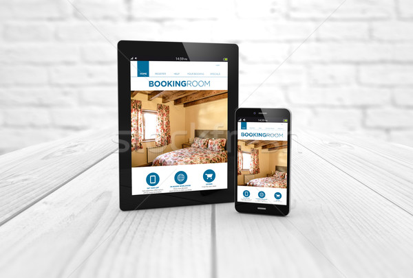 booking web on tablet and smart phone Stock photo © georgejmclittle