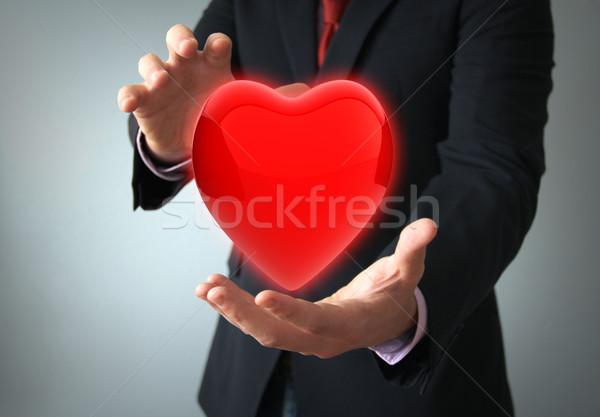 Zorgverzekering liefde concept handen zakenman gezondheid Stockfoto © georgejmclittle