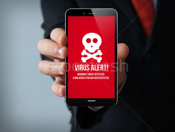 Virus affaires smartphone nouvelle sécurité Photo stock © georgejmclittle
