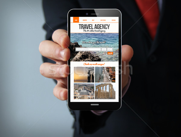 travel agency website on screen businessman smartphone Stock photo © georgejmclittle