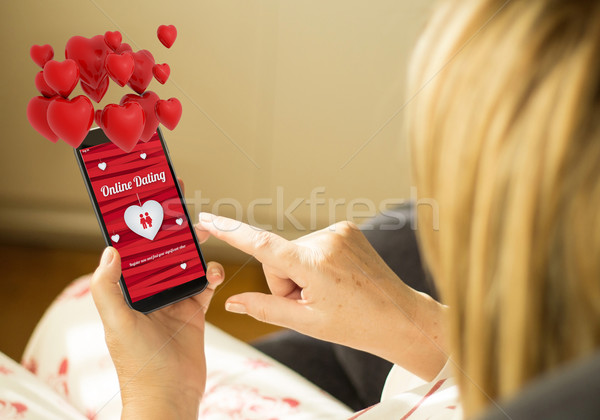 Technology woman online dating with hearts in the air Stock photo © georgejmclittle