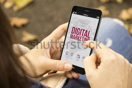 Frau Telefon Park digitalen business woman halten Stock foto © georgejmclittle