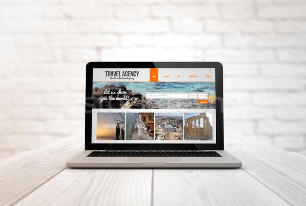 компьютер таблице бюро путешествий туризма генерируется Сток-фото © georgejmclittle