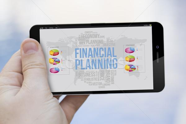 Planification financière téléphone portable communications marketing main Photo stock © georgejmclittle