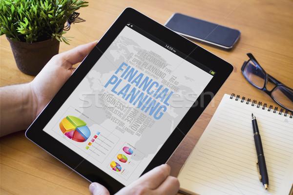 Asztali tabletta pénzügyi tervezés kezek férfi tart Stock fotó © georgejmclittle